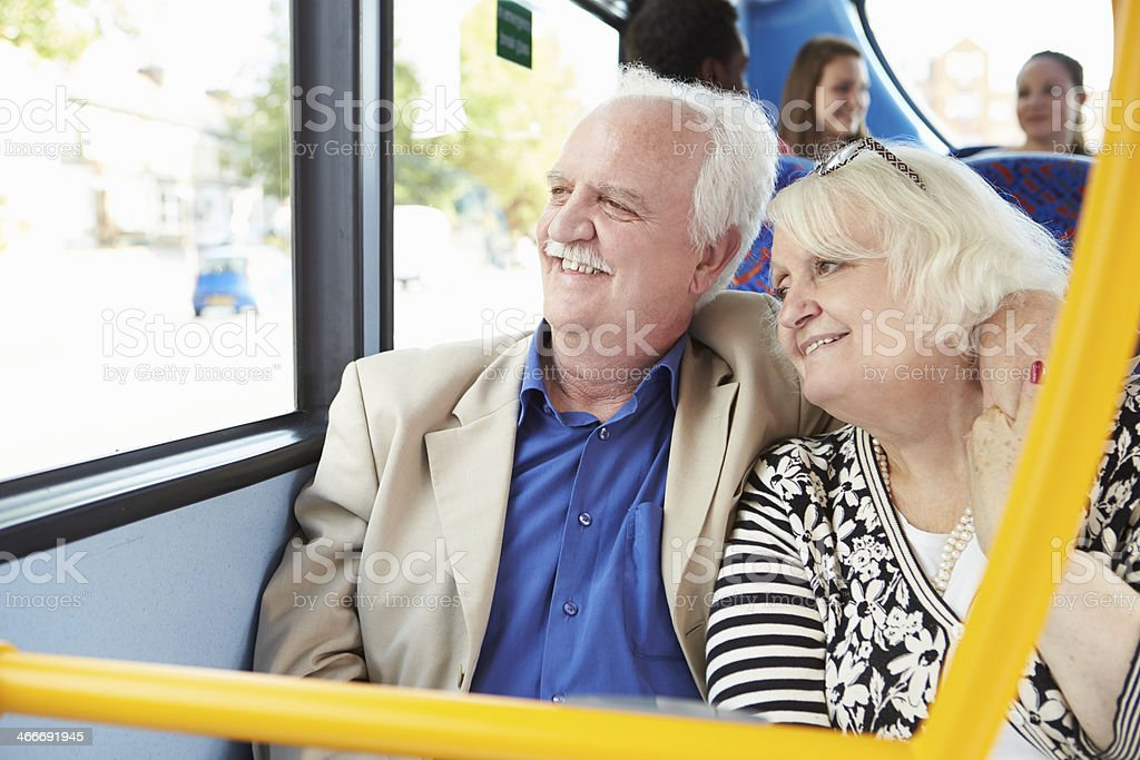 Senior couple looking out of the bus window stock photo