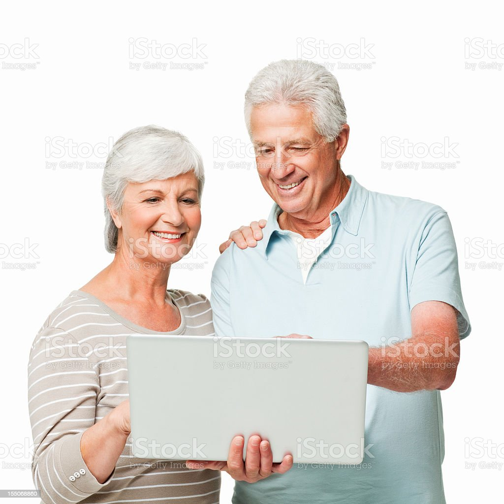 Senior Couple Looking Over a Laptop - Isolated stock photo