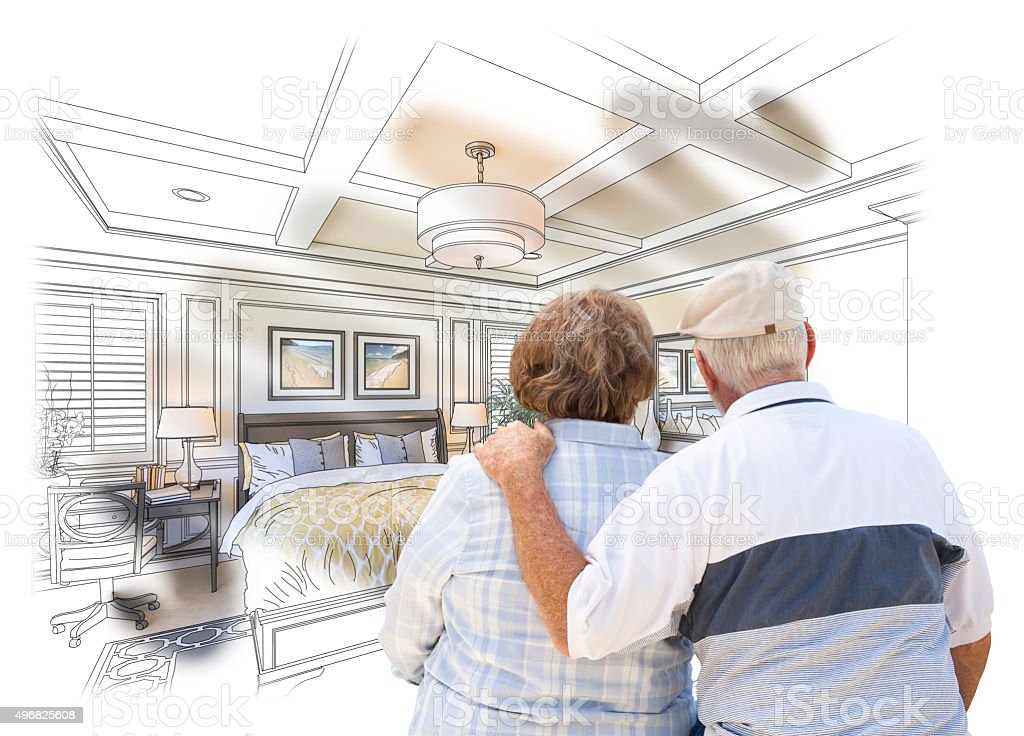 Senior Couple Looking Over Custom Bedroom Design Drawing Photo stock photo
