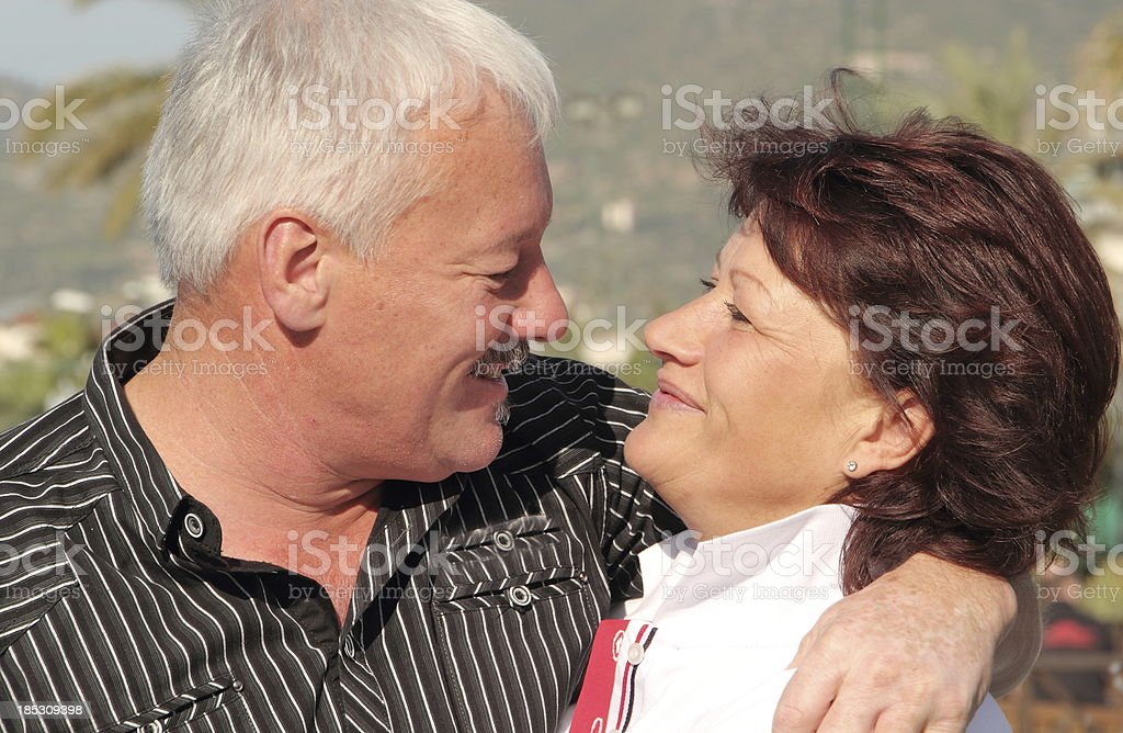 senior couple looking to each other royalty-free stock photo