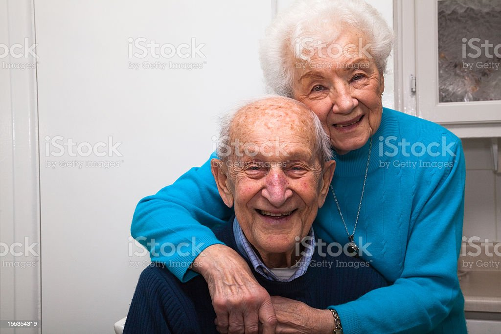 Senior couple married 69 years in their kitchen royalty-free stock photo