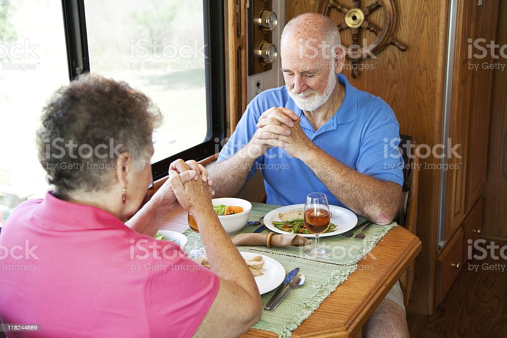 Senior Couple - Mealtime Prayer royalty-free stock photo