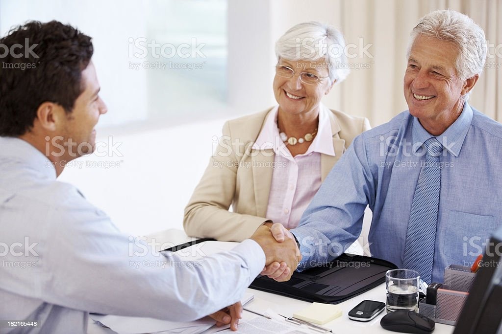 Senior couple meeting with a financial advisor stock photo