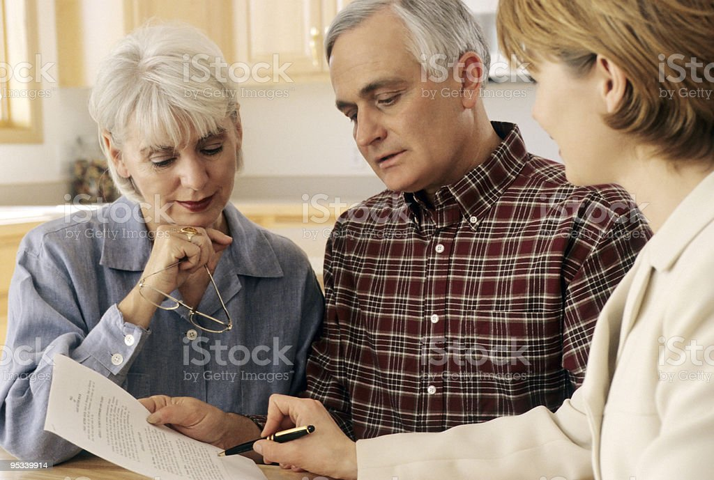 Senior couple meeting with agent stock photo