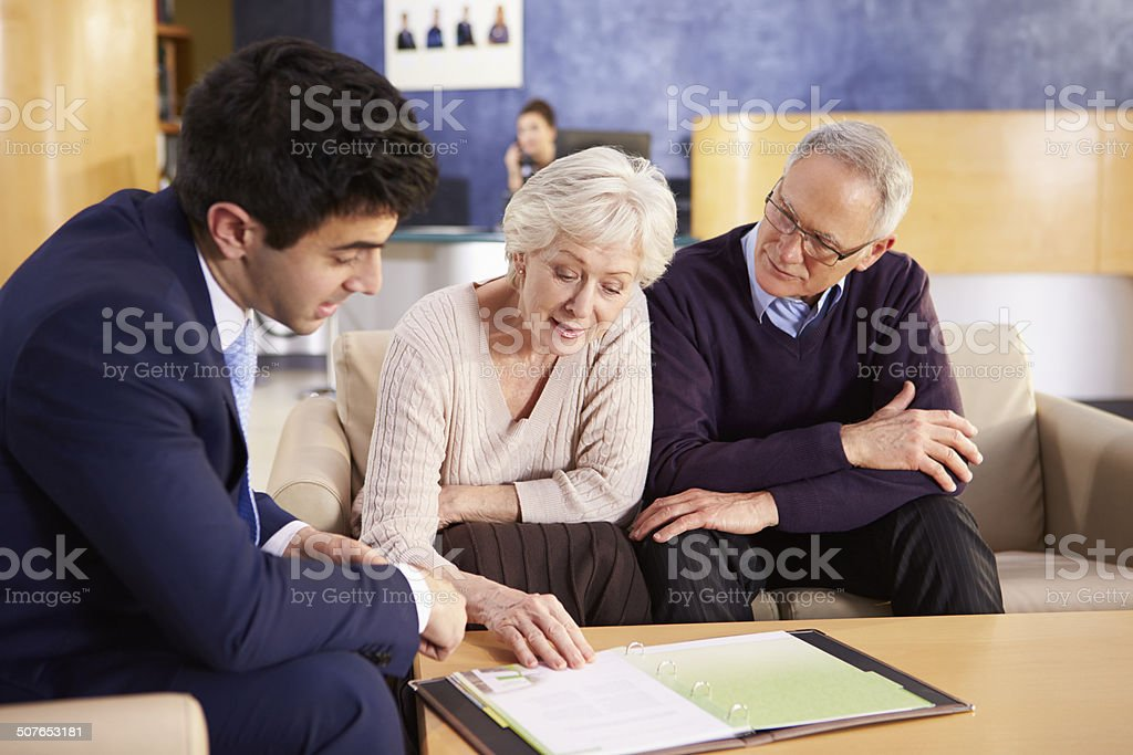 Senior Couple Meeting With Consultant In Hospital stock photo