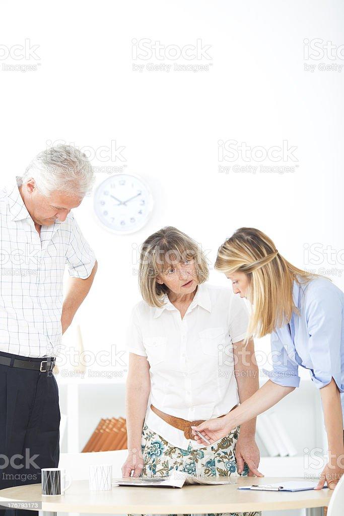 Senior Couple Meeting With Designer. royalty-free stock photo