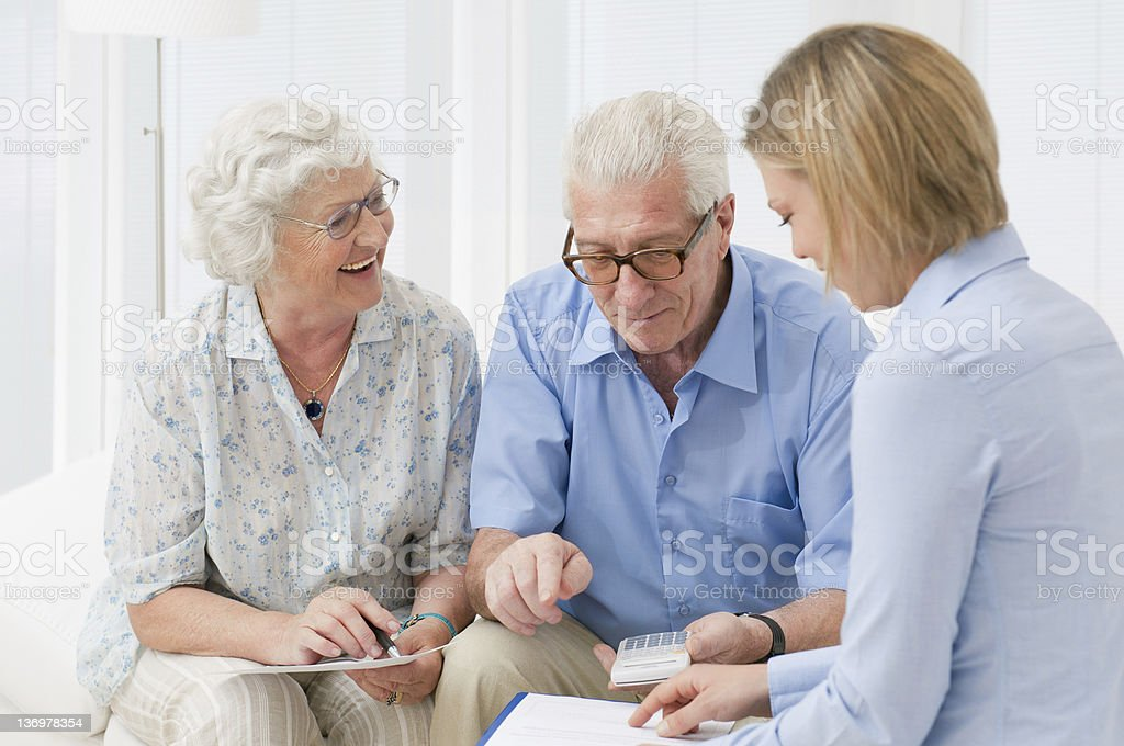 Senior couple meeting with financial adviser royalty-free stock photo