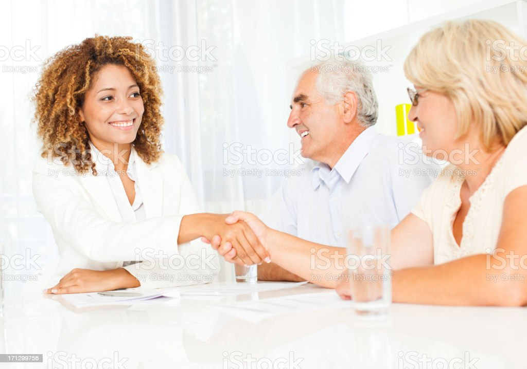 Senior Couple Meeting With Financial Advisor. royalty-free stock photo