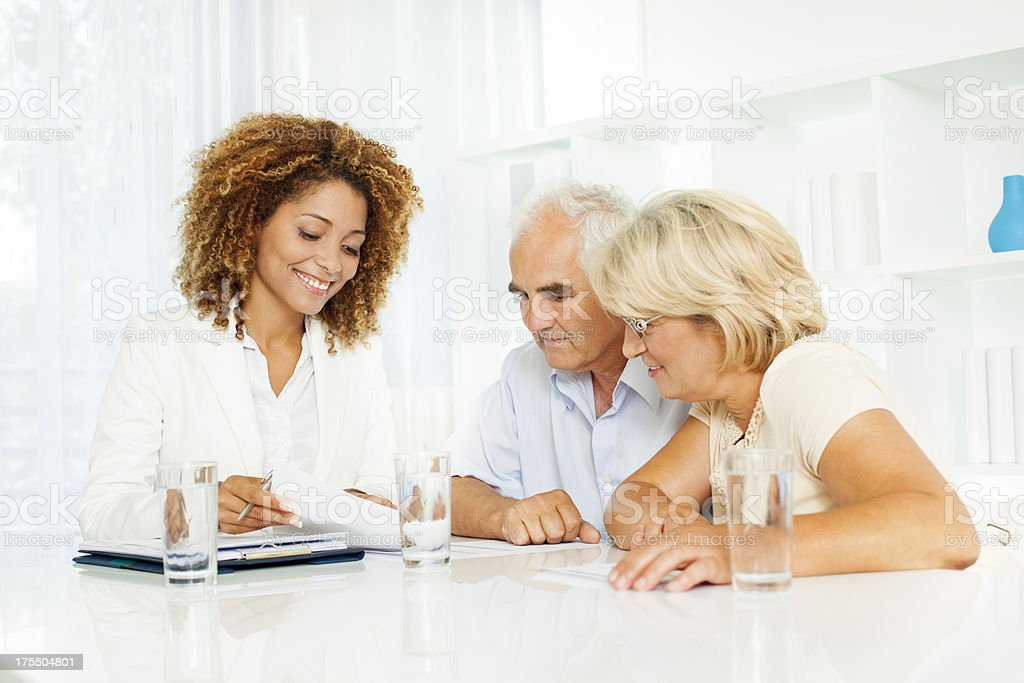 Senior Couple Meeting with Financial advisor. stock photo