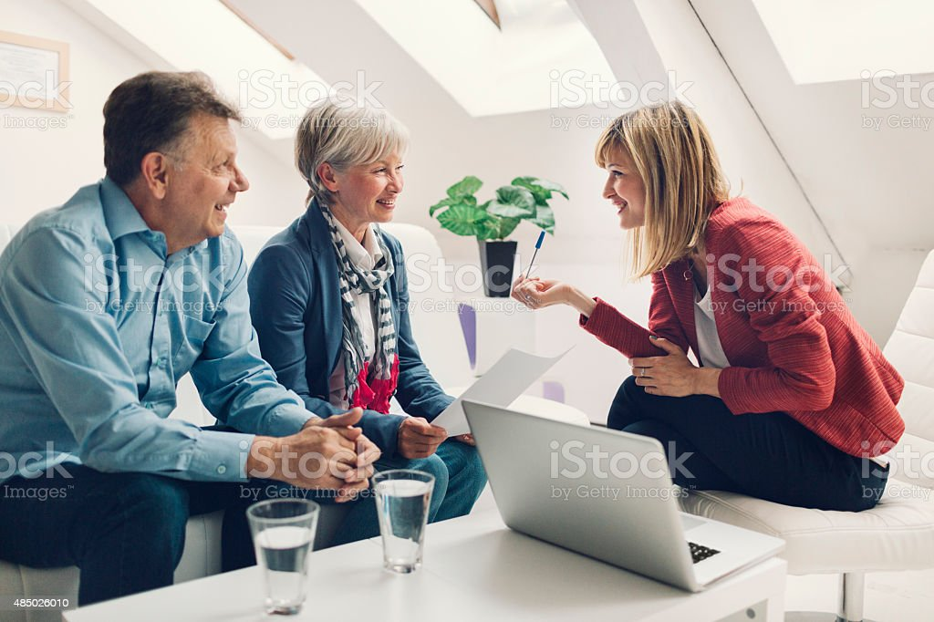 Senior Couple Meeting with Financial Advisor. stock photo