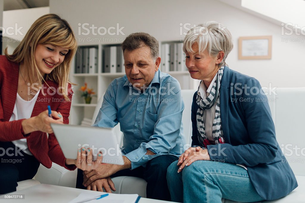 Senior Couple Meeting with Financial Advisor stock photo