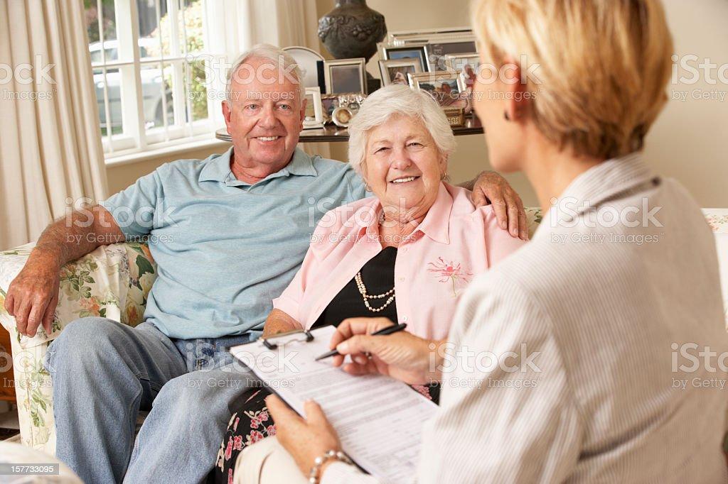 Senior Couple Meets with Advisor royalty-free stock photo