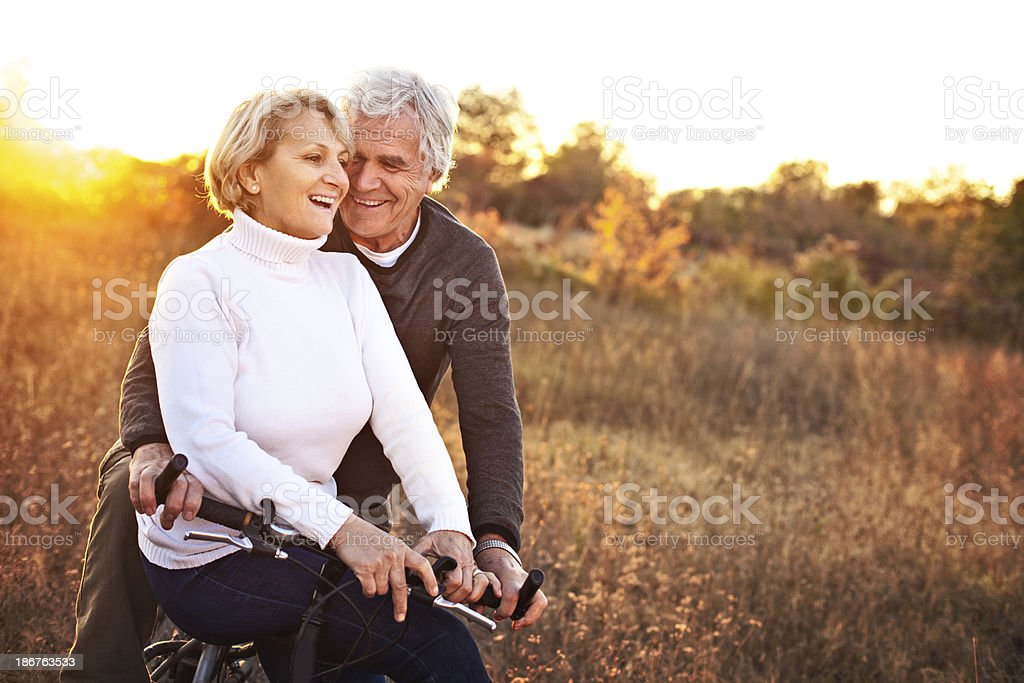 Senior couple on a bicycle royalty-free stock photo
