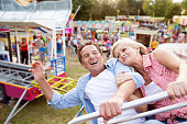 Senior couple on a ride in amusement park