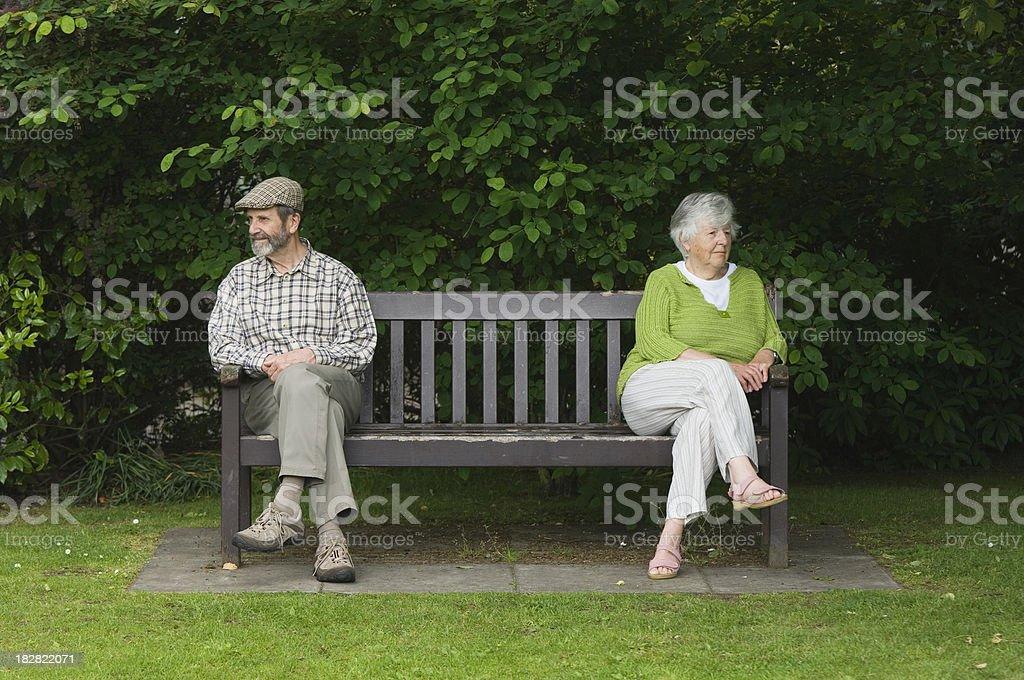 Senior couple on bench royalty-free stock photo
