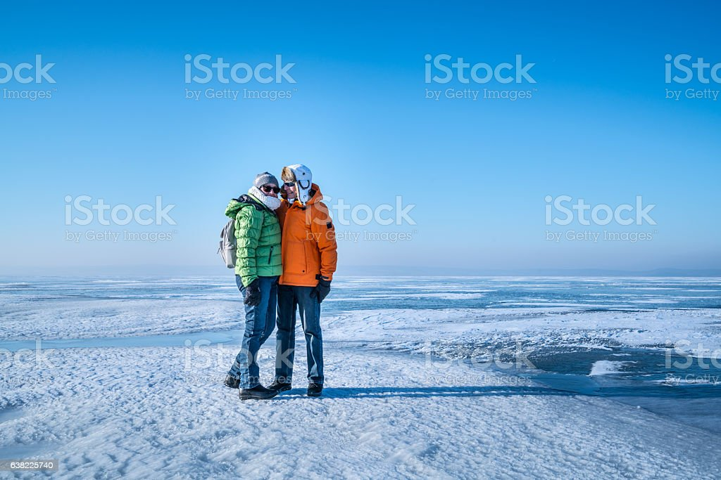 senior couple on big open ice area like arctic stock photo