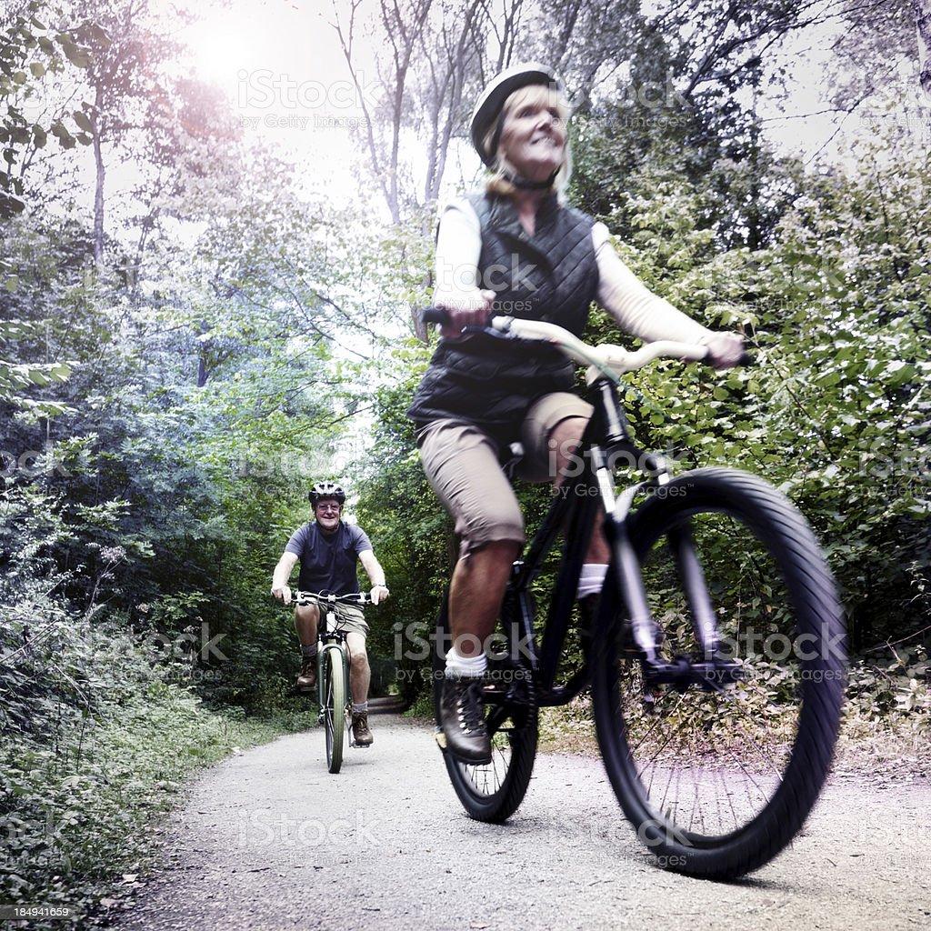 Senior couple on bike ride royalty-free stock photo