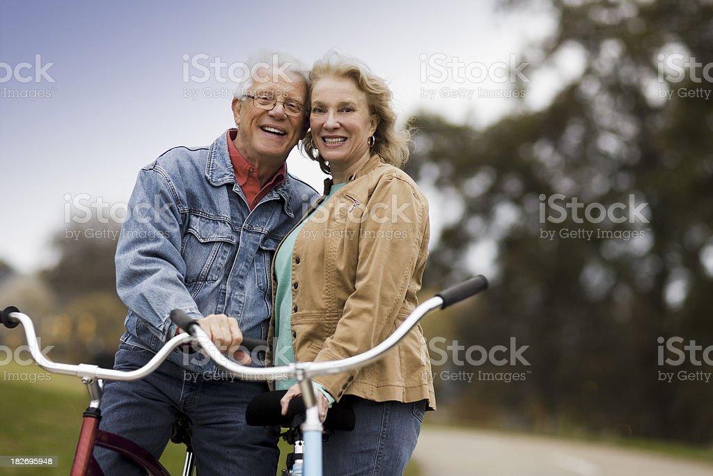 Senior Couple on Bikes stock photo