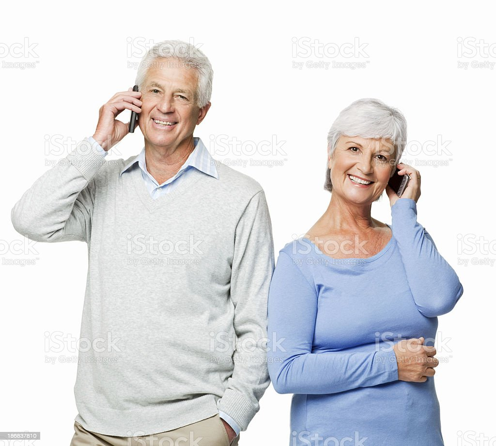 Senior Couple on Cellphones - Isolated royalty-free stock photo