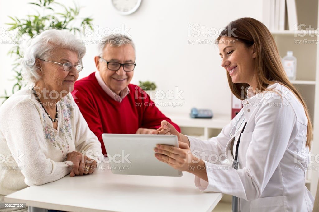 Senior couple on consultation with a doctor stock photo