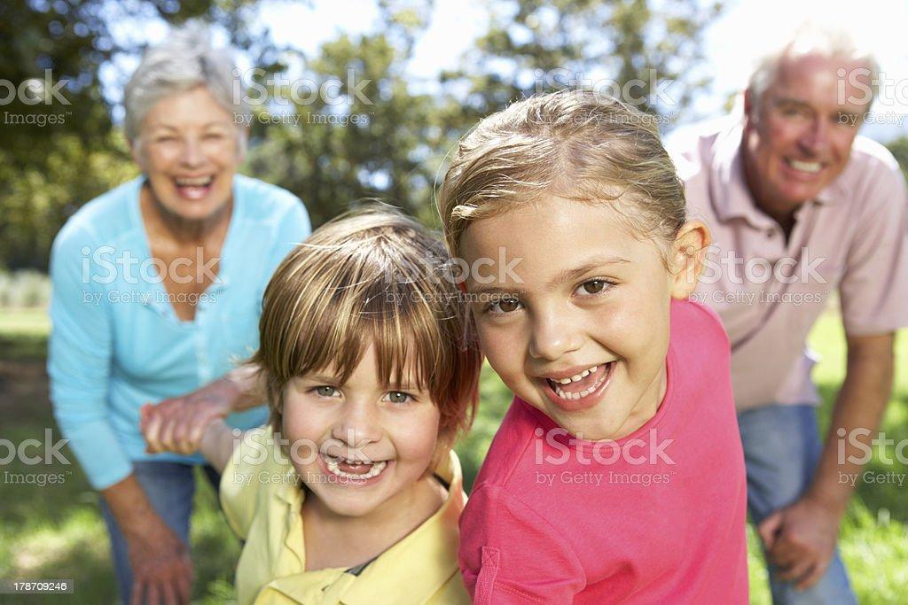 Senior couple on country walk with grandchildren royalty-free stock photo