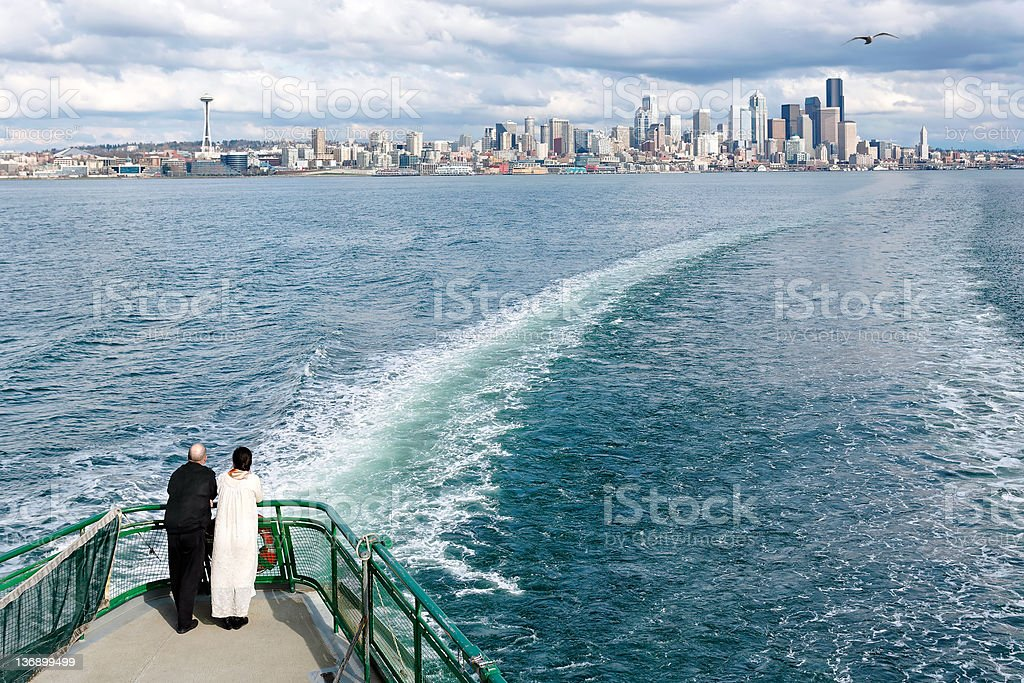 XL senior couple on ferry stock photo