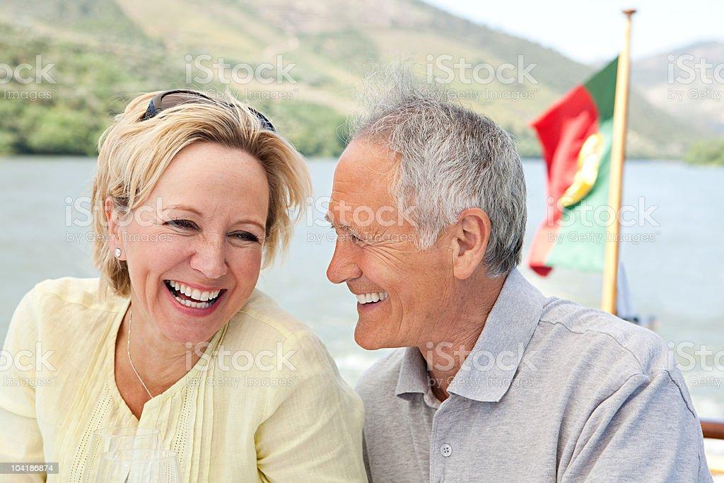 Senior couple on holiday on boat stock photo