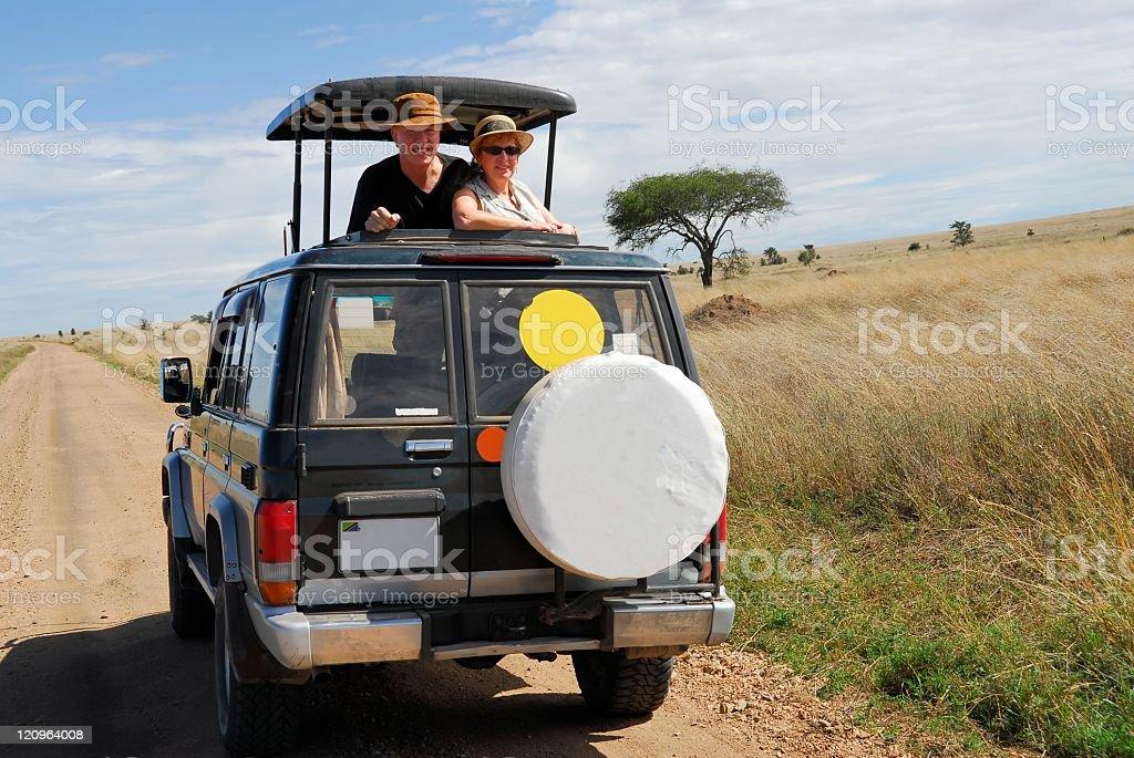 Senior couple on jeep safari in Serengeti,National Park,Tanzania royalty-free stock photo