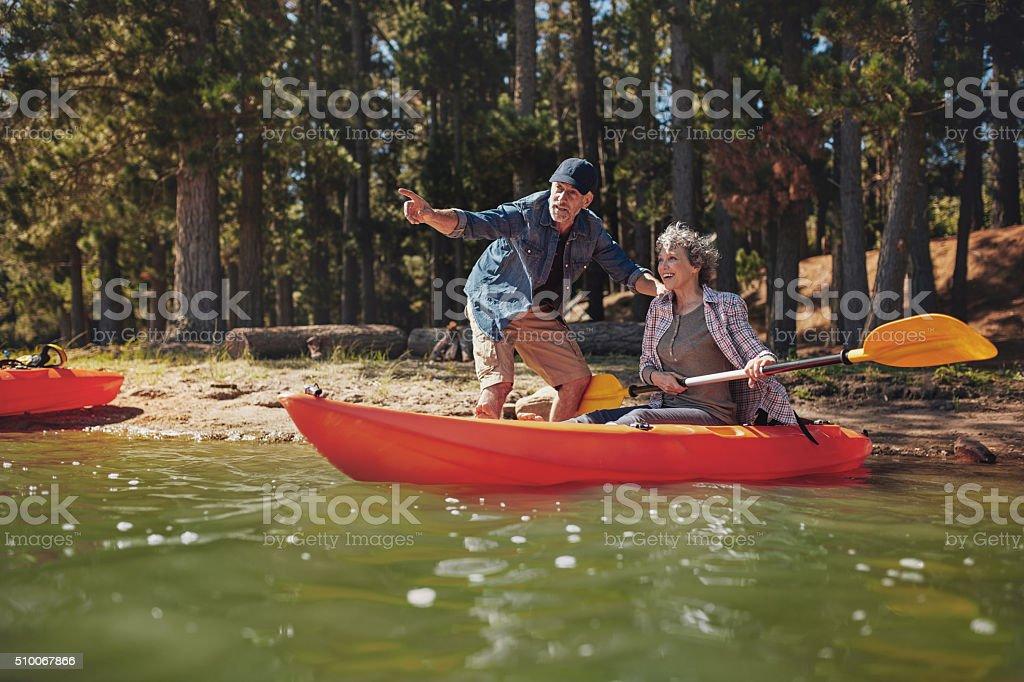 Senior couple on kayak in the lake stock photo