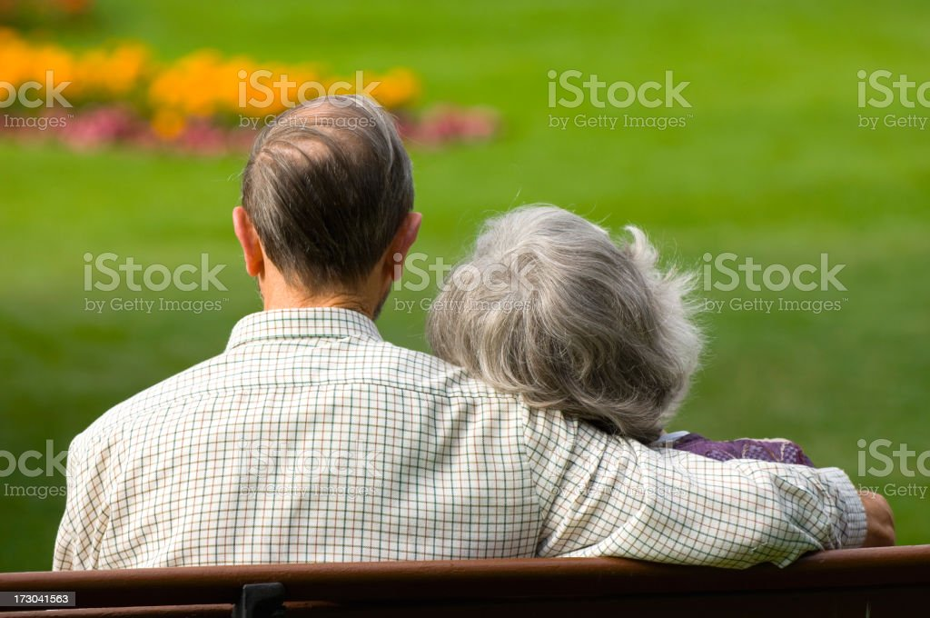 Senior couple on park bench royalty-free stock photo