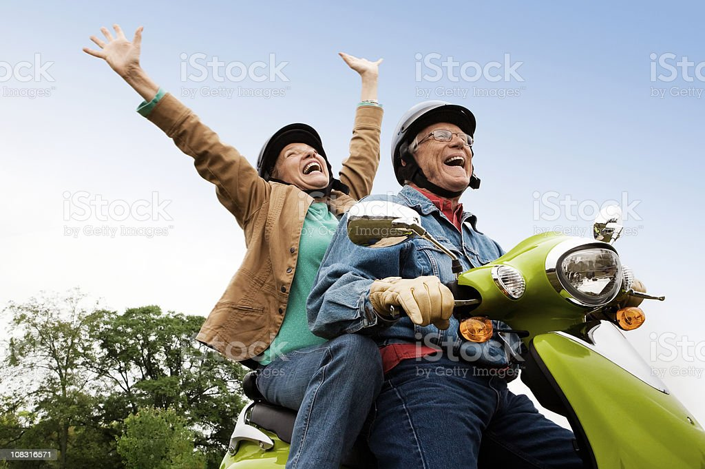 Senior Couple on Scooter stock photo