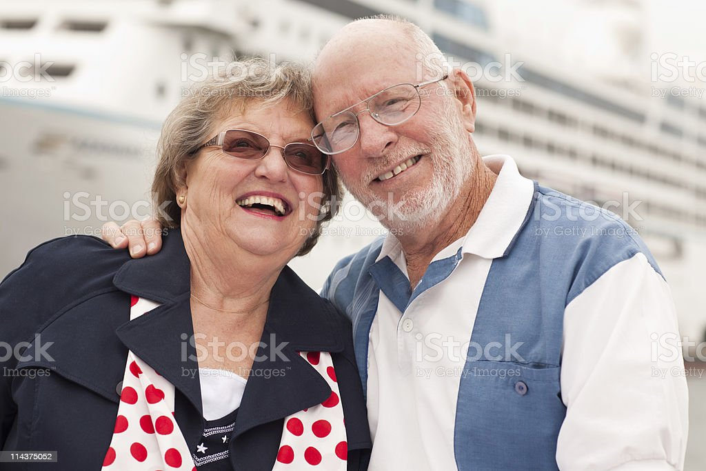 Senior Couple On Shore in Front of Cruise Ship royalty-free stock photo