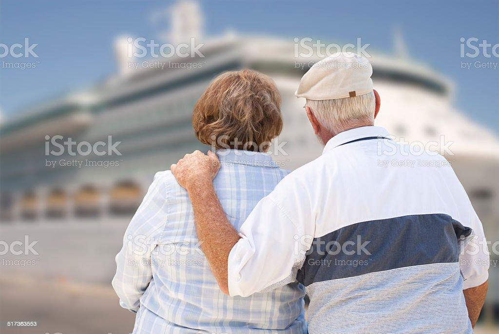 Senior Couple On Shore Looking at Cruise Ship stock photo