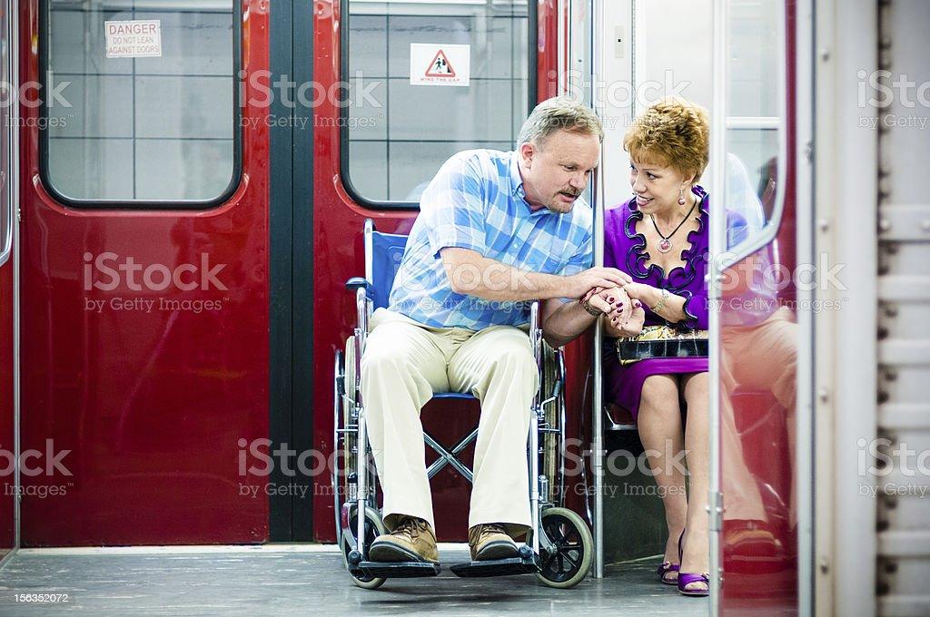 Senior Couple on Subway Train Wheelchair Access royalty-free stock photo