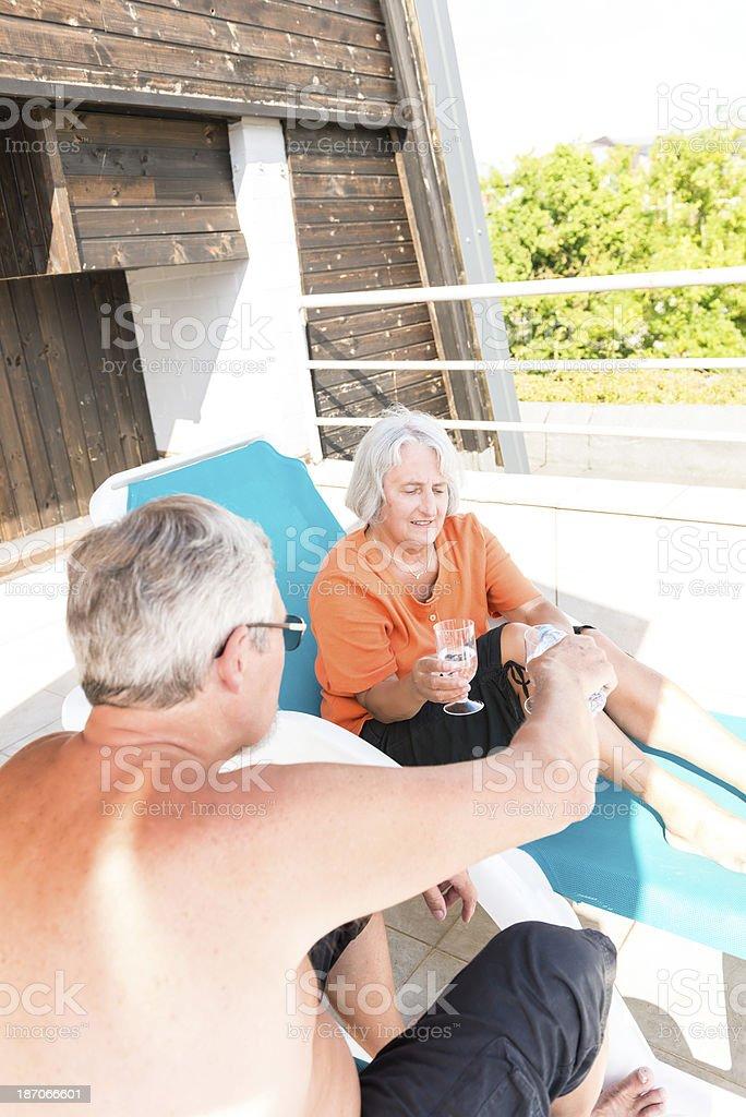 Senior couple on terrace royalty-free stock photo