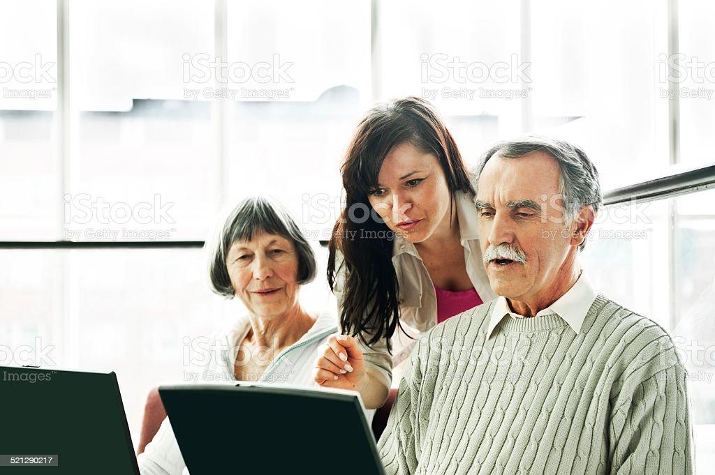 Senior couple on the seminar stock photo