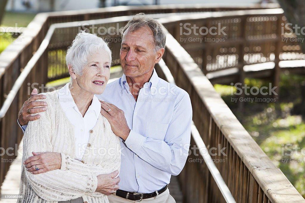 Senior couple on wooden walkway stock photo