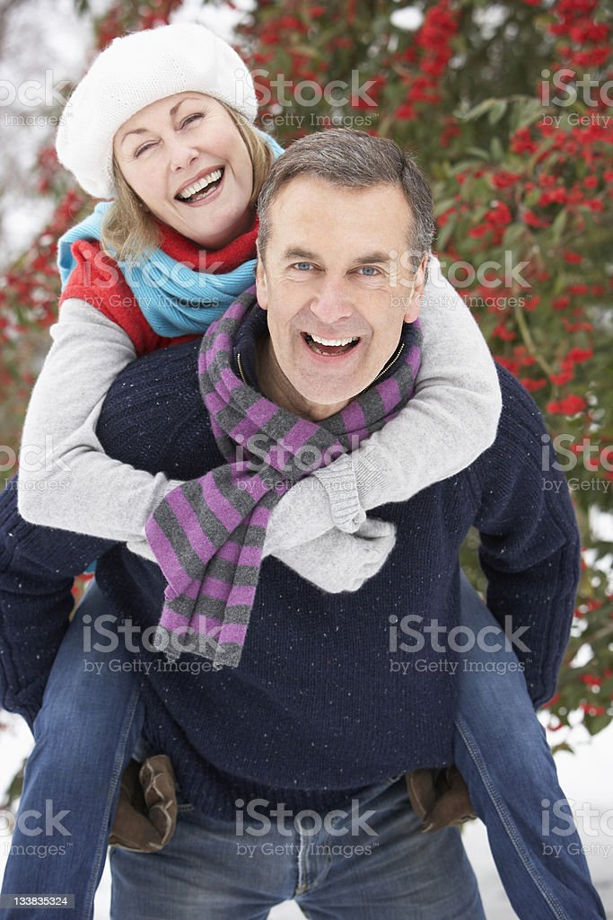Senior Couple Outside In Snowy Landscape royalty-free stock photo