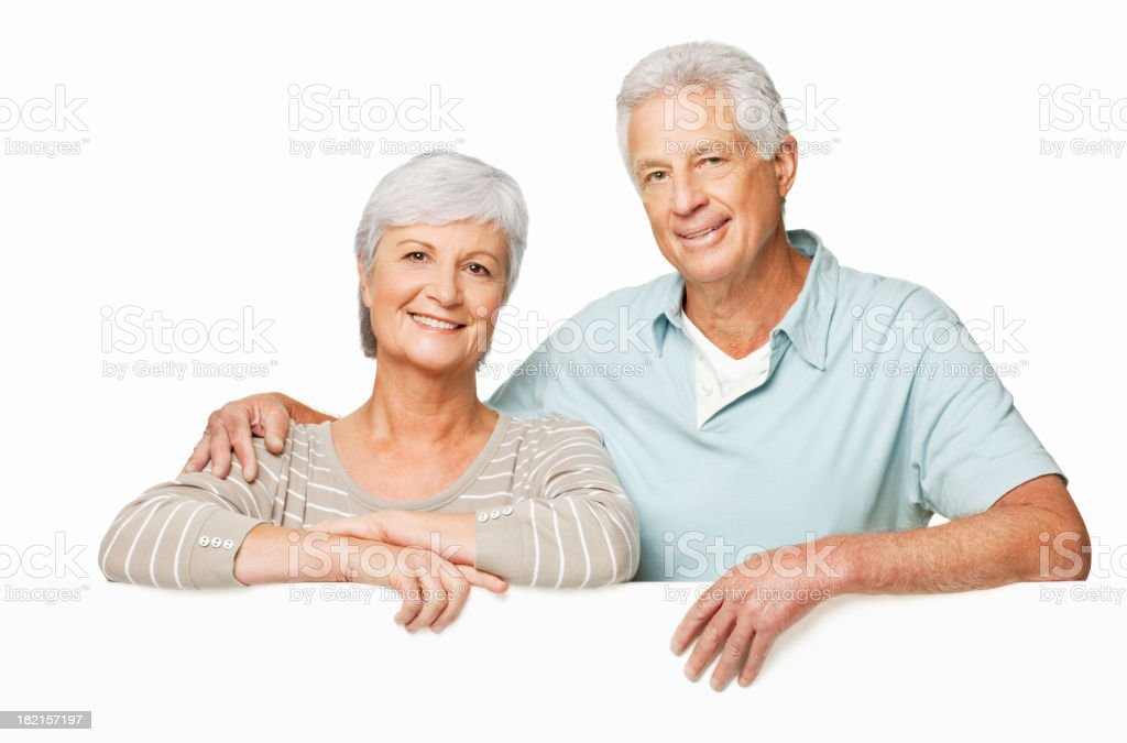 Senior Couple Over a Wall - Isolated royalty-free stock photo