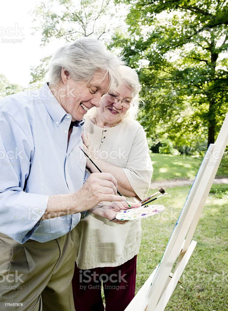 Senior Couple Painting in the Park royalty-free stock photo