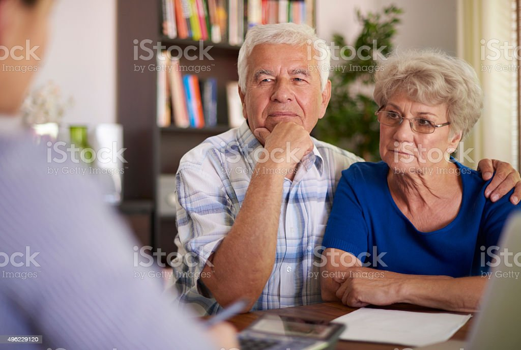 Senior couple paying a visit at accountant stock photo
