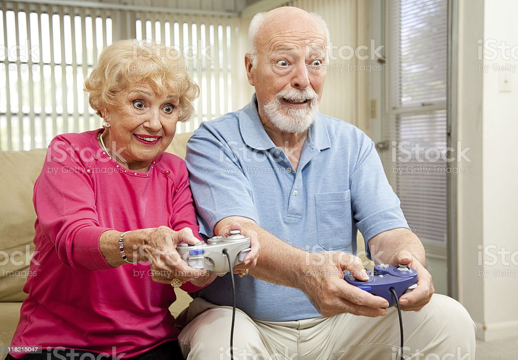 Senior Couple Play Video Games royalty-free stock photo