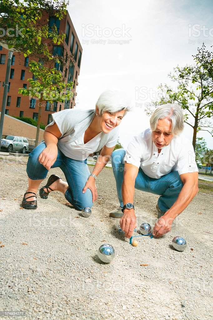 senior couple playing a game of boule royalty-free stock photo