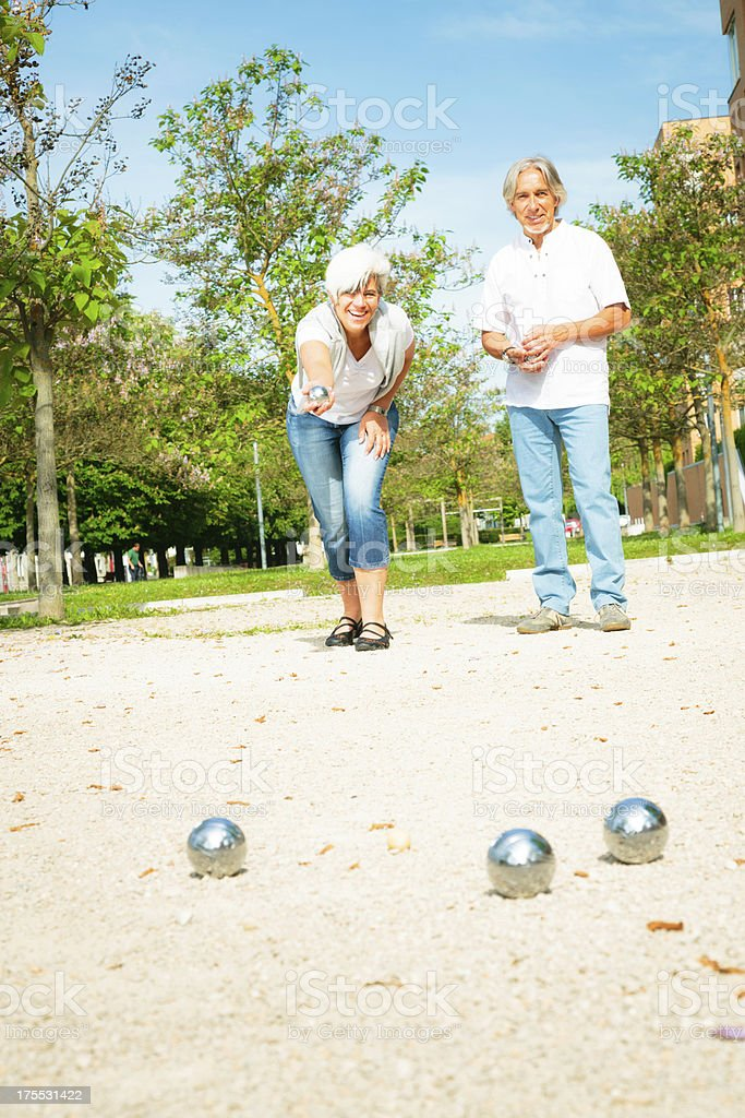 senior couple playing a game of boule stock photo