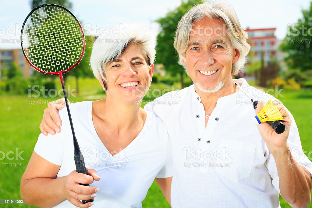 senior couple playing badminton royalty-free stock photo