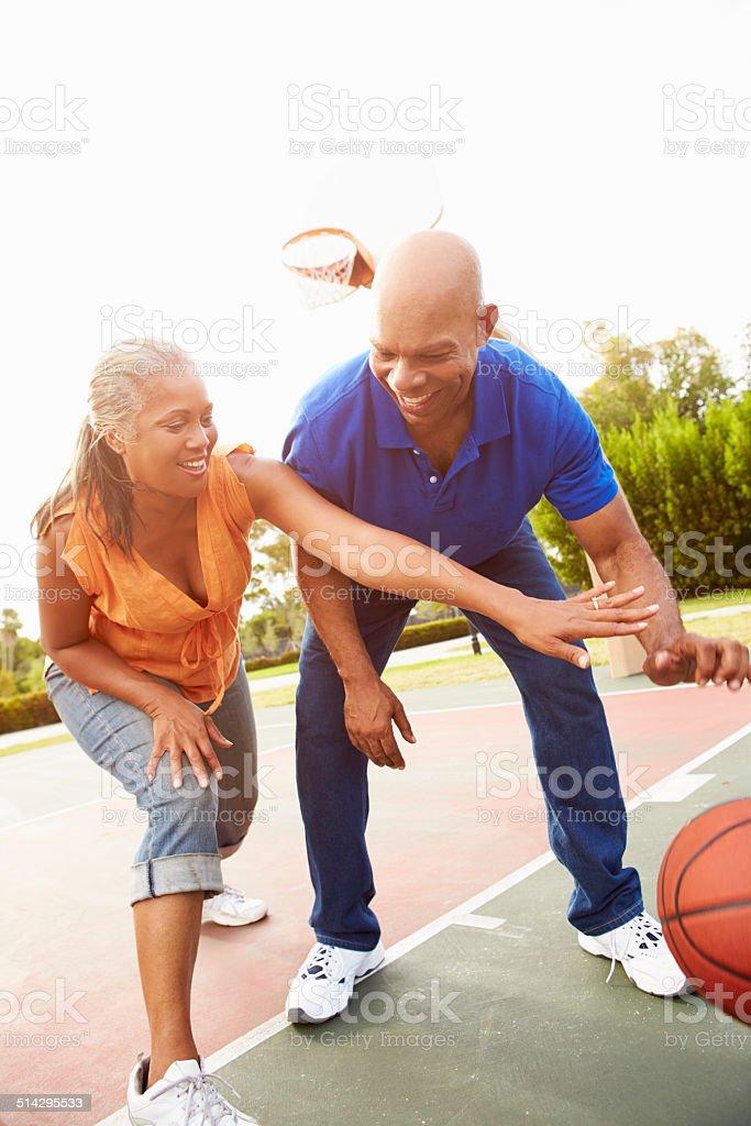Senior Couple Playing Basketball Together stock photo