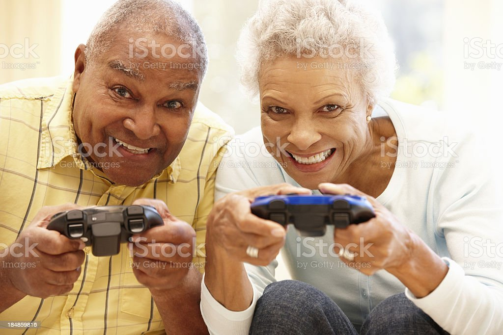 Senior couple playing computer games royalty-free stock photo