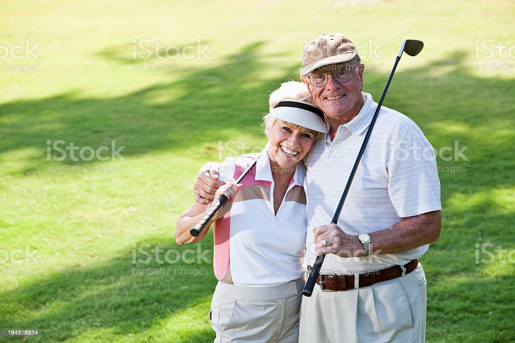 Senior couple playing golf royalty-free stock photo
