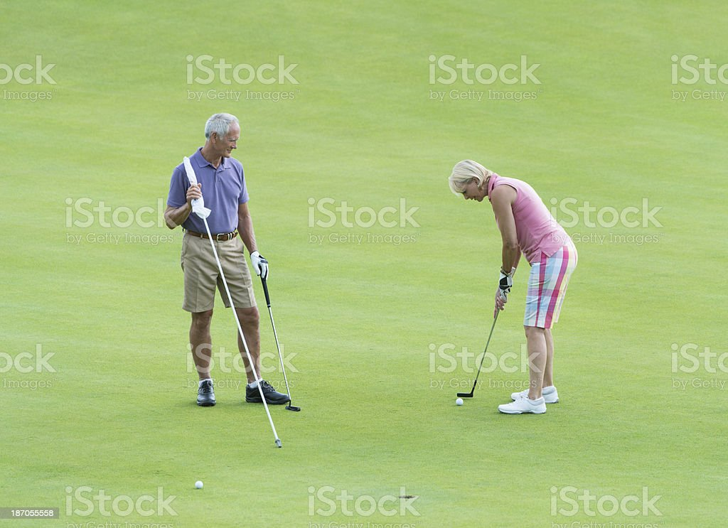 Senior Couple Playing Golf royalty-free stock photo