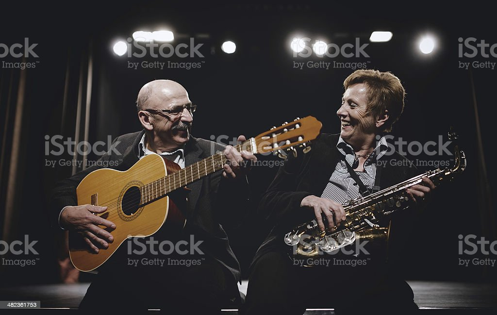 Senior couple playing on stage theater